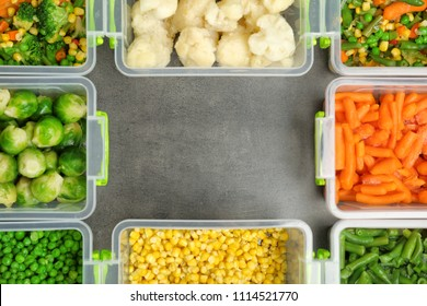 Flat lay composition with frozen vegetables on grey background