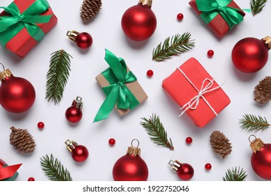 Flat lay composition with gift boxes and Christmas decor on white background