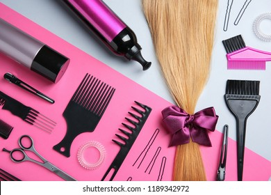Flat lay composition with hair salon tools on color background