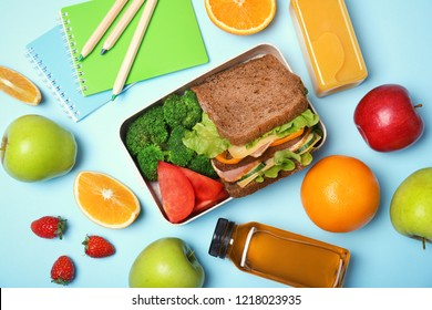 Flat lay composition with healthy food for school child on color background