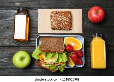 Flat lay composition with healthy food for school child on wooden background