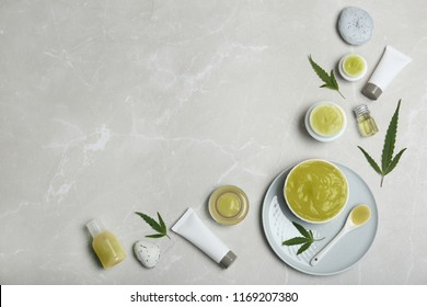 Flat lay composition with hemp lotion on grey background