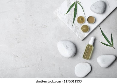 Flat lay composition with hemp lotion and space for text on light background