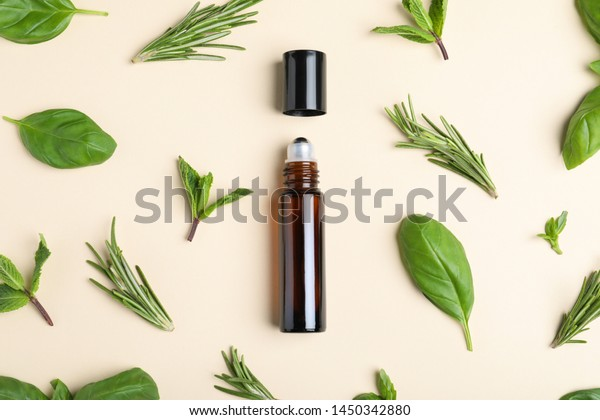 Flat lay composition with herbal essential oil on beige background