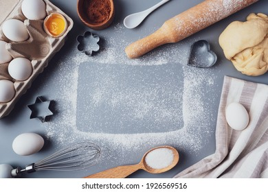 Flat Lay composition, ingredients for baking cookies on a gray background, copy space. Making cookies or cupcakes for Valentine's Day, Mother's Day, Father's Day. The concept of festive food.