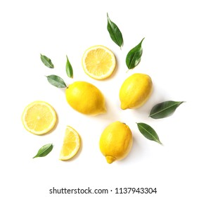 Flat lay composition with lemons and leaves on white background