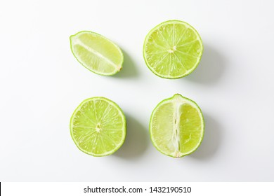 Flat lay composition with limes on white background, space for text
