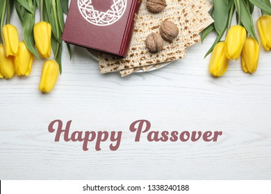 Flat lay composition with matzo and Torah on wooden background. Happy Passover (Pesach)