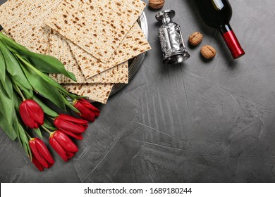 Flat lay composition with matzos on dark background, space for text. Passover (Pesach) celebration