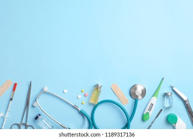 Flat lay composition with medical items and space for text on color background