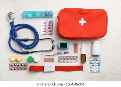 Flat lay composition with medical objects on white wooden background