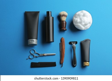 Flat lay composition with men's cosmetic products on color background. Space for design
