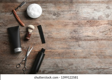 Flat lay composition with men's cosmetic products on wooden background. Space for design