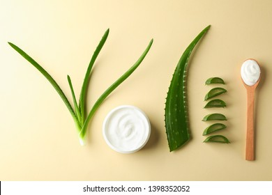 Flat lay composition with natural treatment accessories on color background, space for text and top view. Aloe vera