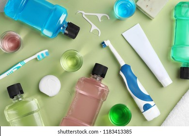Flat lay composition with oral care products on color background. Teeth hygiene