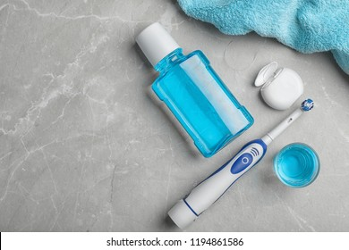 Flat lay composition with oral care products and space for text on light background. Teeth hygiene