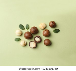 Flat lay composition with organic Macadamia nuts on color background