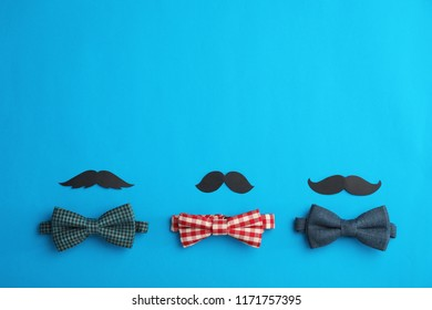 Flat lay composition with paper moustaches, bow ties and space for text on color background. Happy Father's Day
