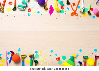 Flat lay composition with party items on wooden background. Space for text
