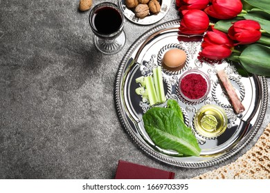 Flat lay composition with Passover Seder plate (keara) on grey table, space for text. Pesah celebration