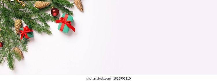 Flat lay composition with pinecones on white background, space for text. Horizontal banner design
