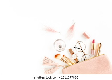 Flat lay composition with pink cosmetic bag with cosmetic makeup products, isolated on white background. Flat lay, top view.