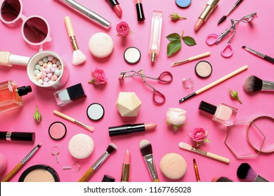 Flat lay composition with products for decorative makeup on pink background