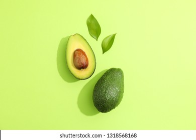 Flat lay composition with ripe avocados on white background, space for text. Top view