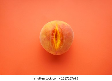 Flat lay composition with ripe peach on a orange background. Sex concept