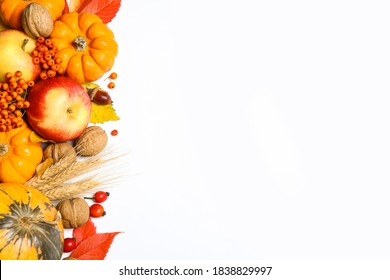 Flat lay composition with ripe pumpkins and autumn leaves on white background, space for text. Happy Thanksgiving day