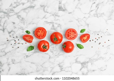 Flat lay composition with ripe tomatoes on marble background