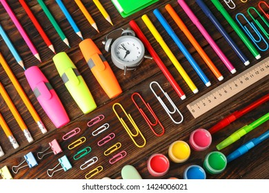 Flat lay composition with school supplies on wooden background
