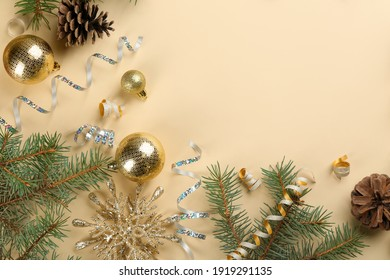 Flat lay composition with serpentine streamers and Christmas decor on beige background. Space for text