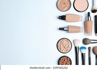 Flat lay composition with skin foundation, powder and beauty accessories on white background. Space for text