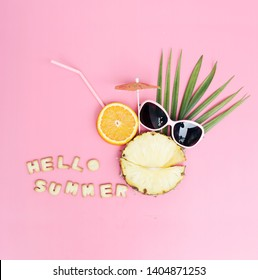 Flat lay composition with slice pineapple,palm leaves,sunglasses and on pastel background/ summer consept background