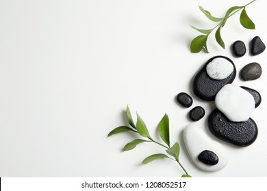 Flat lay composition with spa stones and space for text on white background
