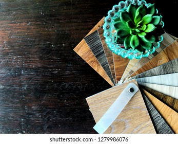 Flat lay composition space copy : vinyl flooring tiles sample stack for floor renovate or DIY home Decorate