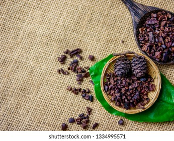 Flat lay composition space on sack fabric cloth with rough grinding organic Cacao nips for healthy lifestyle concept