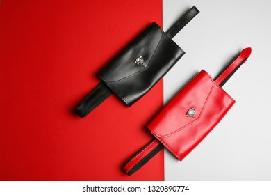 Flat lay composition of stylish bum bags on color background