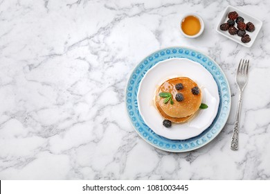 Flat lay composition with tasty pancakes on marble background