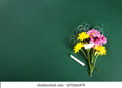 Flat lay composition for Teacher's day on chalkboard