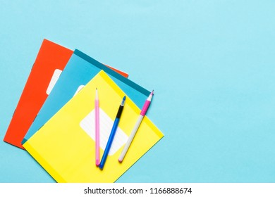 Flat lay composition with various laptops on a colored blue background. School accessories, the idea back to school