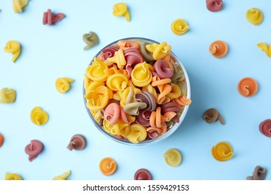 Flat lay composition with vegetable vesuvio pasta on light blue background