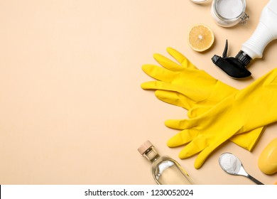 Flat lay composition with vinegar and cleaning supplies on color background. Space for text