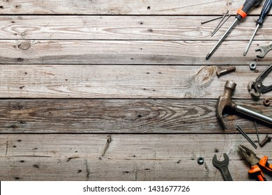 Flat lay composition with vintage carpentry tools on rough wooden background. Top view workbench with carpenter different tools. Woodworking, craftsmanship and handwork concept.
