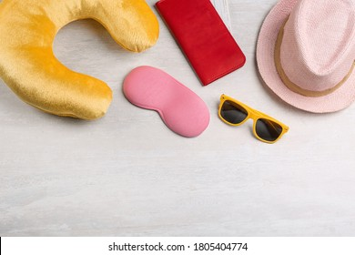 Flat lay composition with yellow travel pillow on light background, space for text