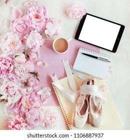 flat lay concept with tablet, writing pad, pen and beautiful peonies, can be used as background
