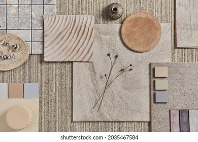 Flat lay of creative architect moodboard composition with samples of building, neutral textile and natural materials and personal accessories. Top view, template.