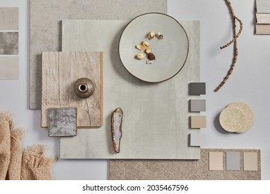 Flat lay of creative architect moodboard composition with samples of building, textile and natural materials and personal accessories. Top view,  white background, template.