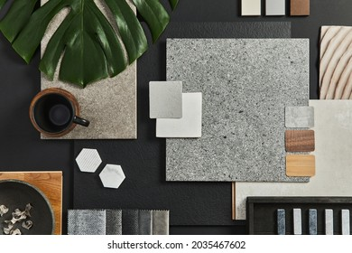Flat lay of creative architect moodboard composition with samples of building, textile and natural materials and personal accessories. Top view, black backgroung, template.